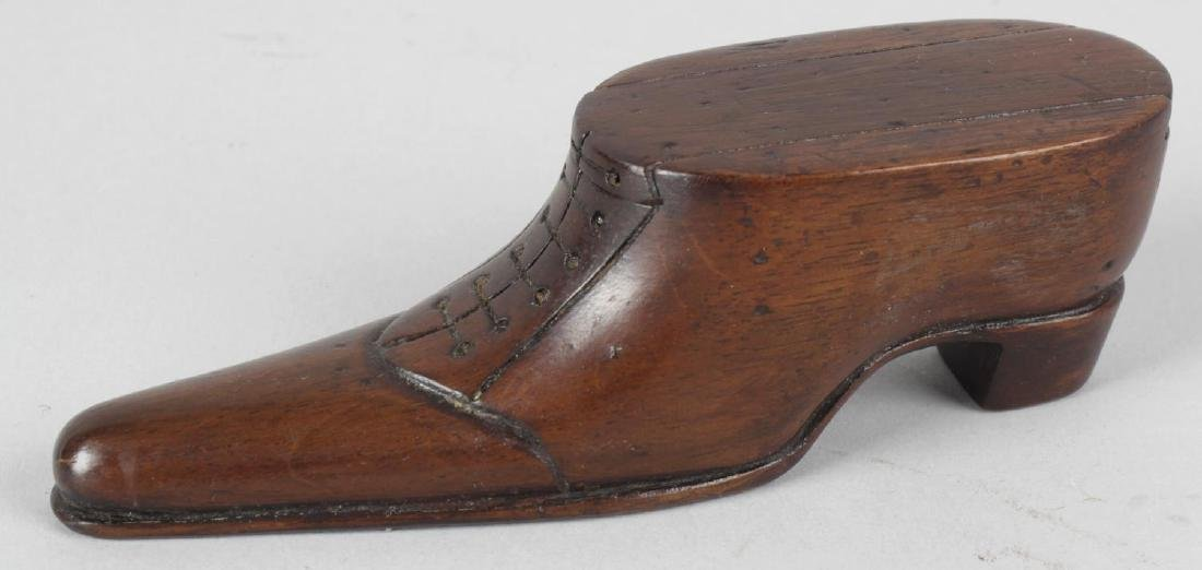 A novelty carved wooden snuff box, modelled as a shoe