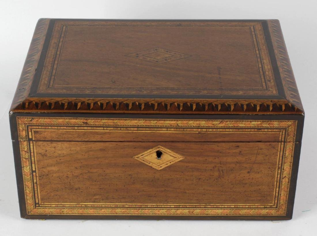 Three Victorian inlaid walnut boxes. The first with