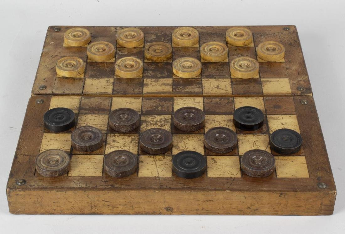 Two late 19th century games boxes. The first having a