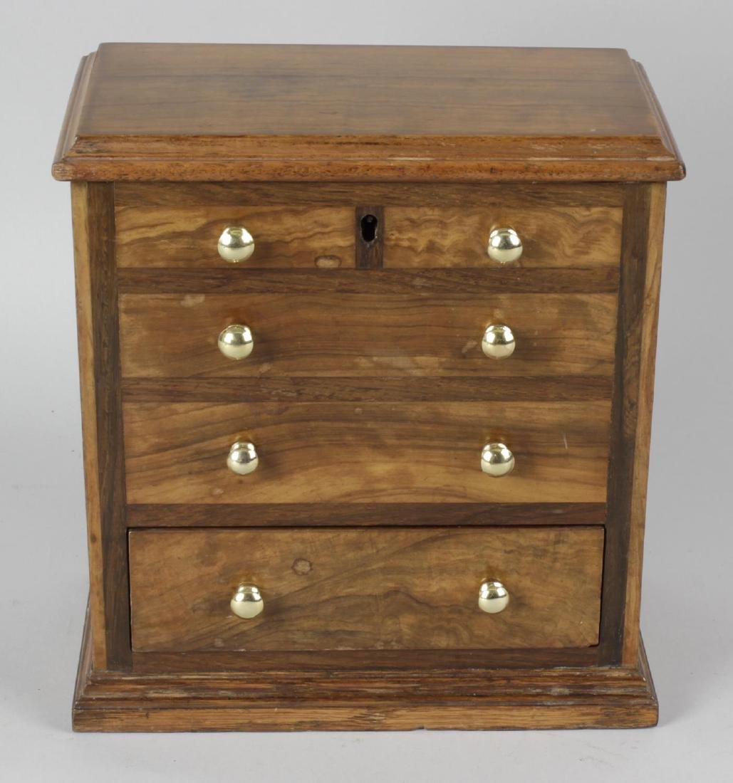 A late 19th century walnut box modelled as a chest of