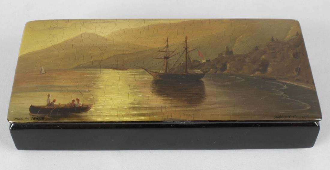 A Russian lacquered papier mache rectangular box, the