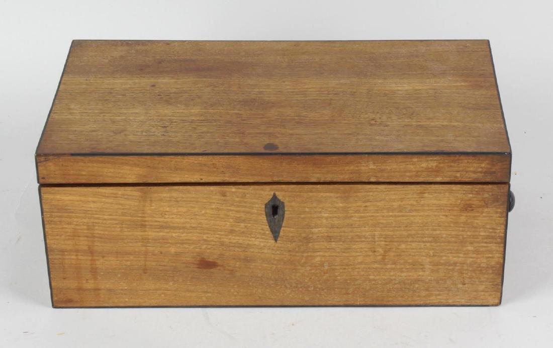 A Regency mahogany dressing box. The hinged rectangular