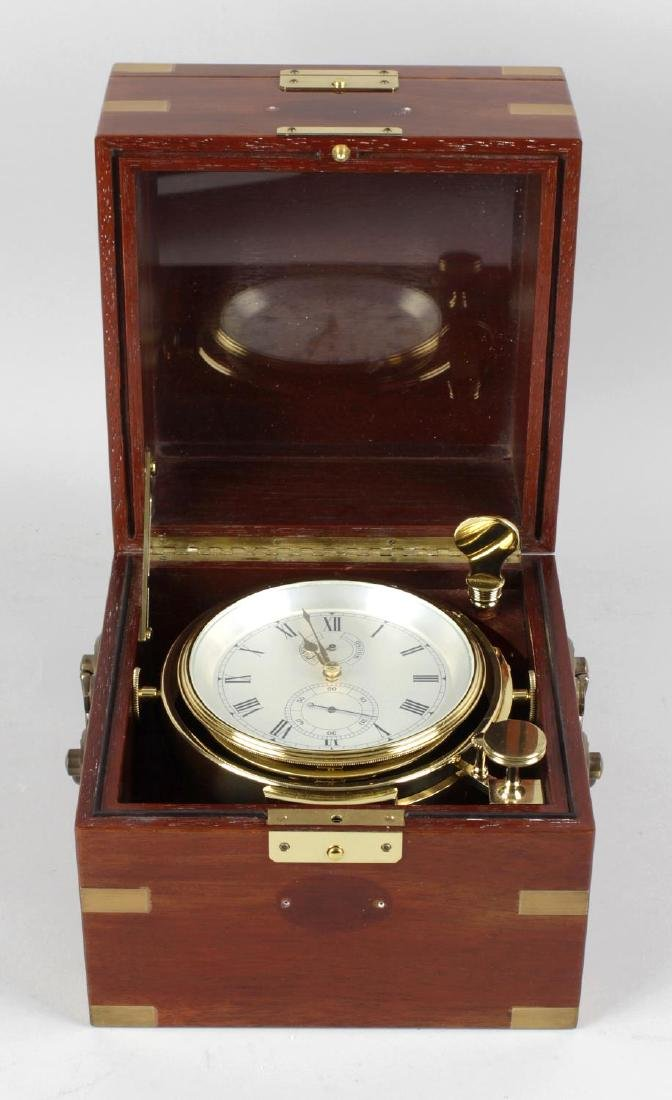 A modern Asprey's marine chronometer in brass capped