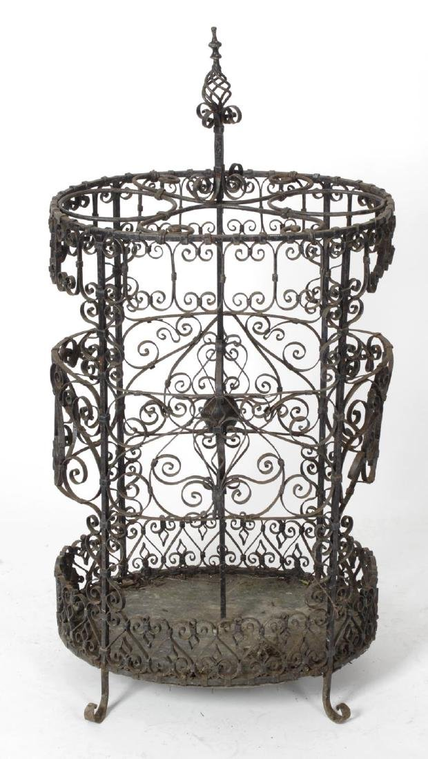 A black painted wrought metal stick and umbrella stand,