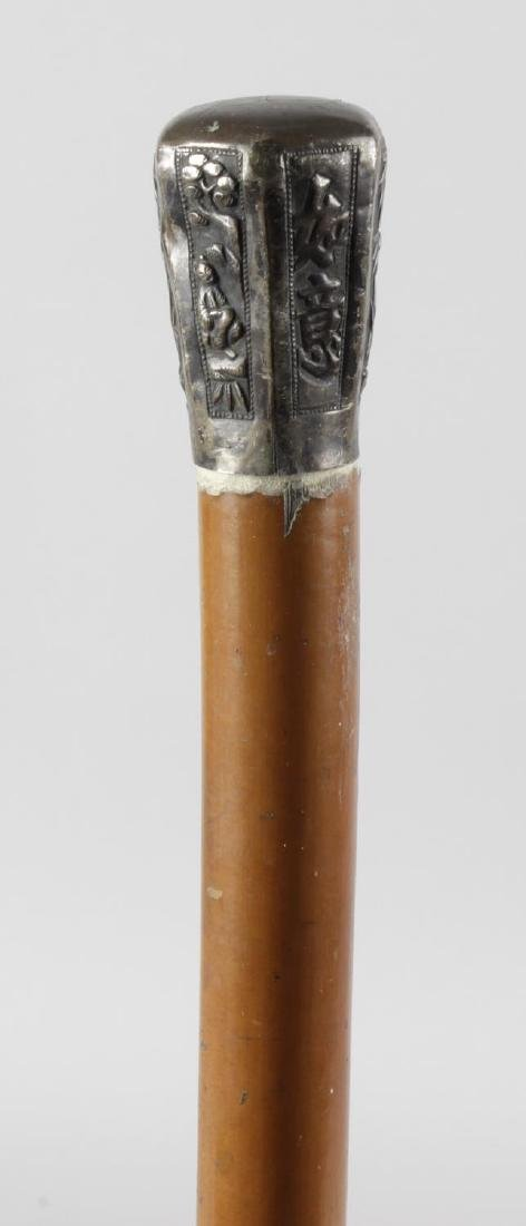A 19th century walking cane, the Eastern white metal