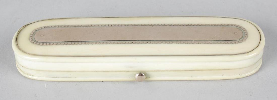 A 19th century ivory toothpick case, the shaped hinged
