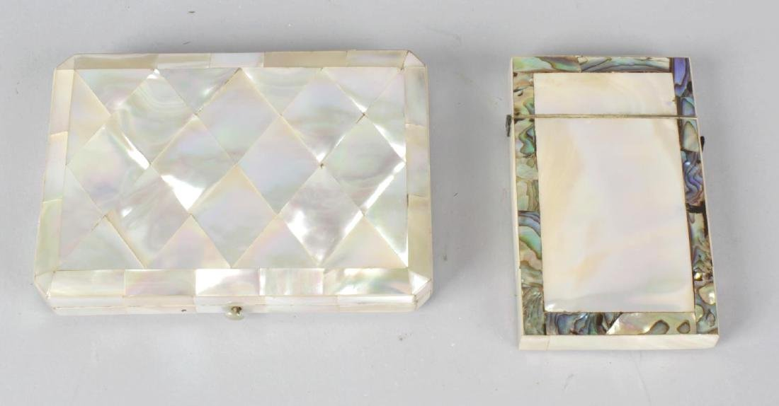 Two mother of pearl and abalone shell visiting card
