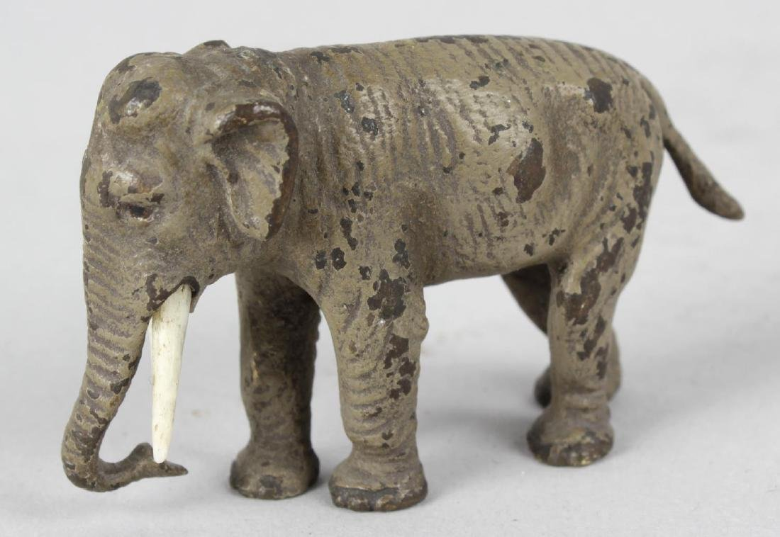 A cold painted bronze study of a standing elephant, his