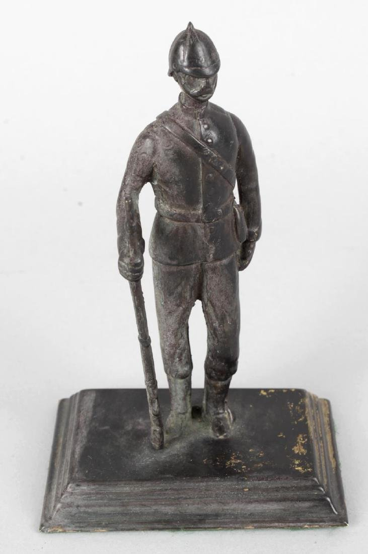 A bronze figure modelled as a Victorian Boer War