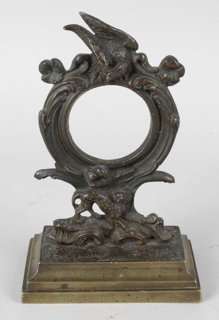 A 19th century bronze pocket watch stand, the open