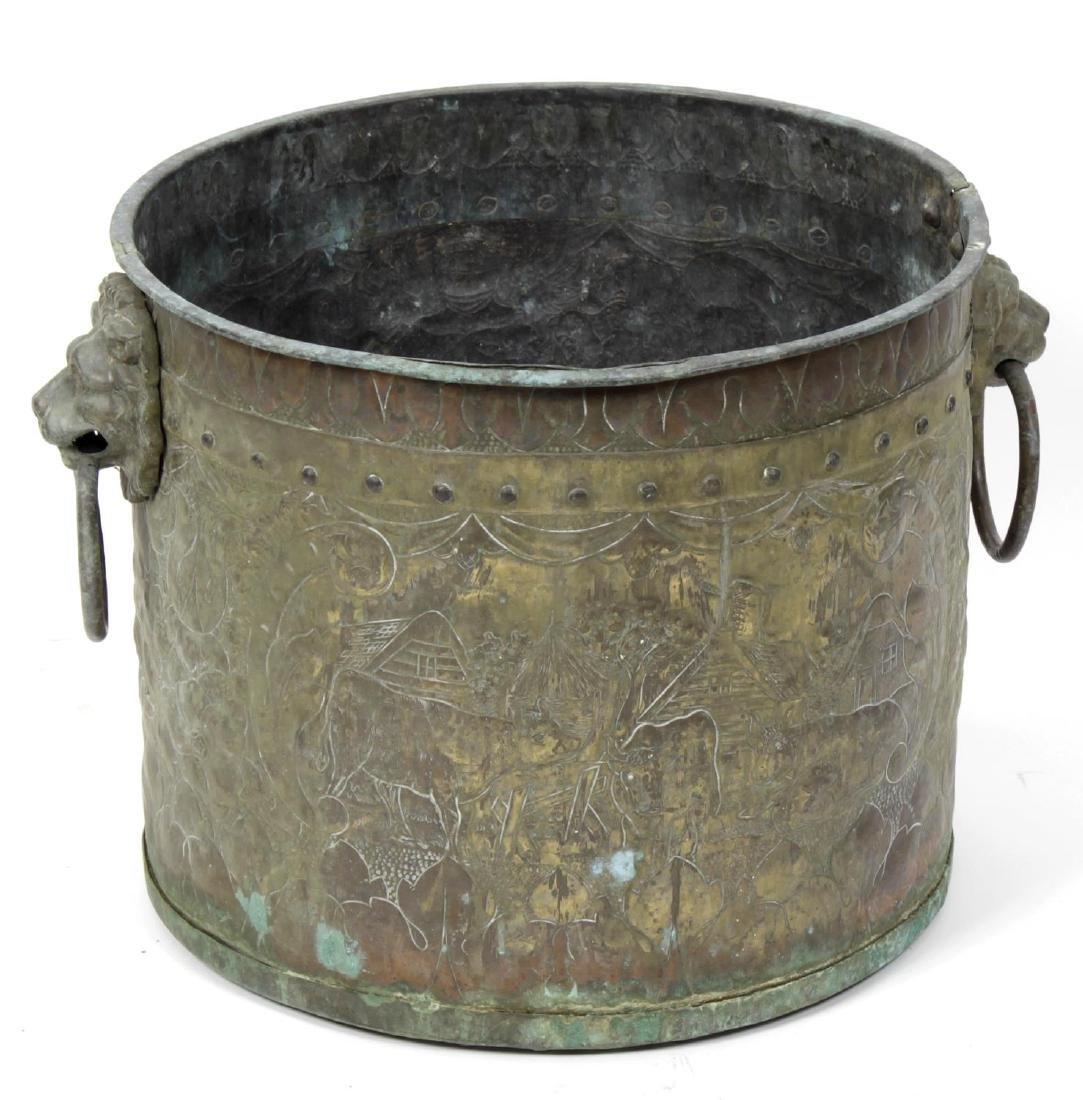 A 19th century Dutch brass log bin and an alms dish.