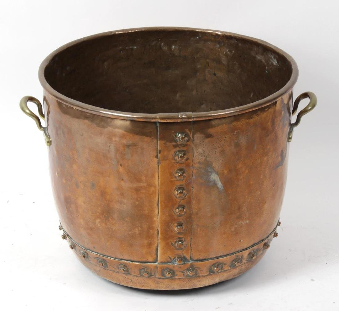A large 19th century copper log bin. The hammered