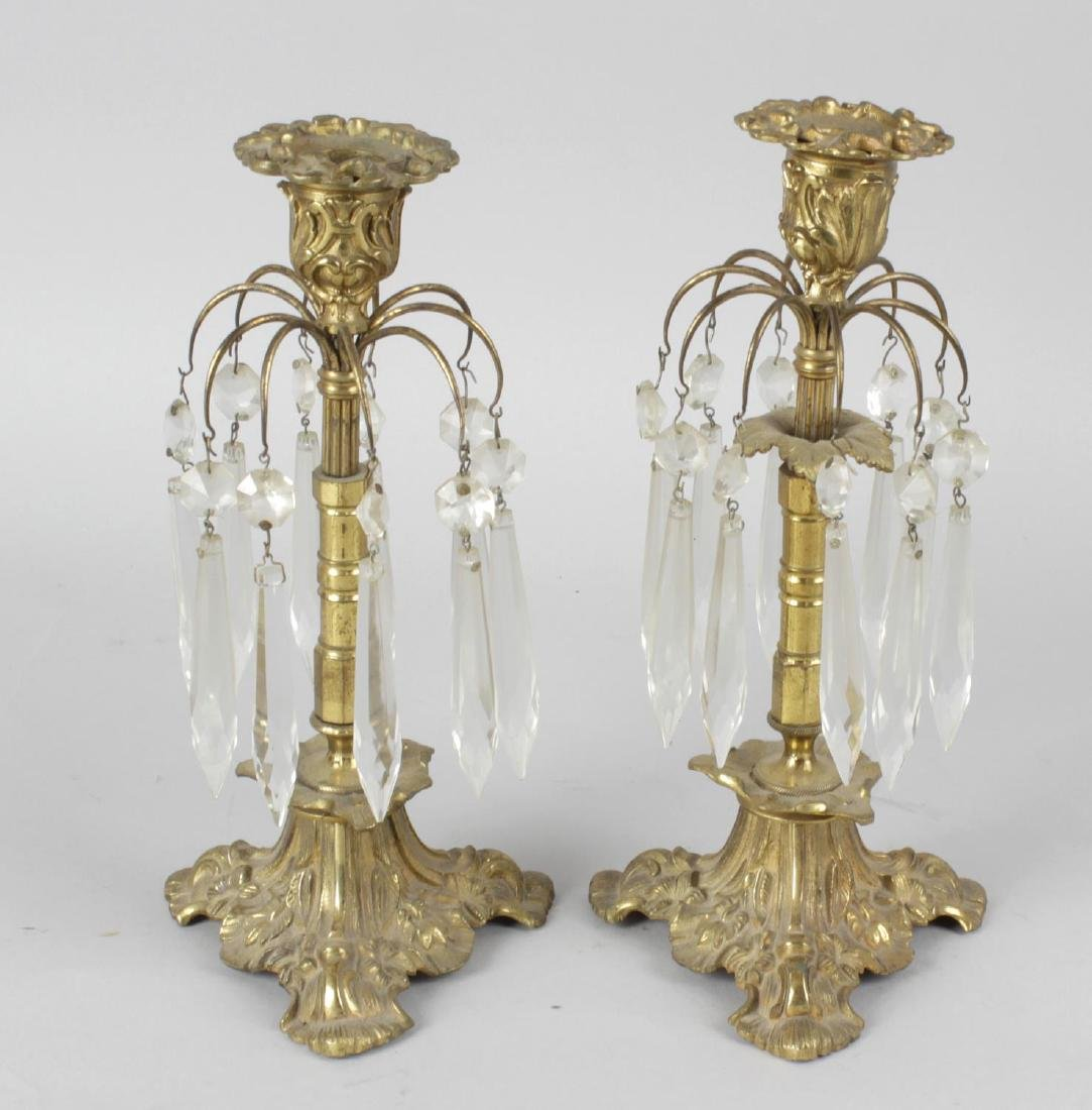 A pair of late 19th century gilt lustre candle sticks,