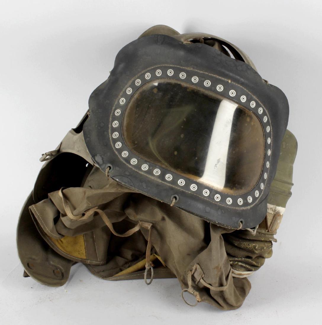 A World War II baby respirator (gas mask). The tinted