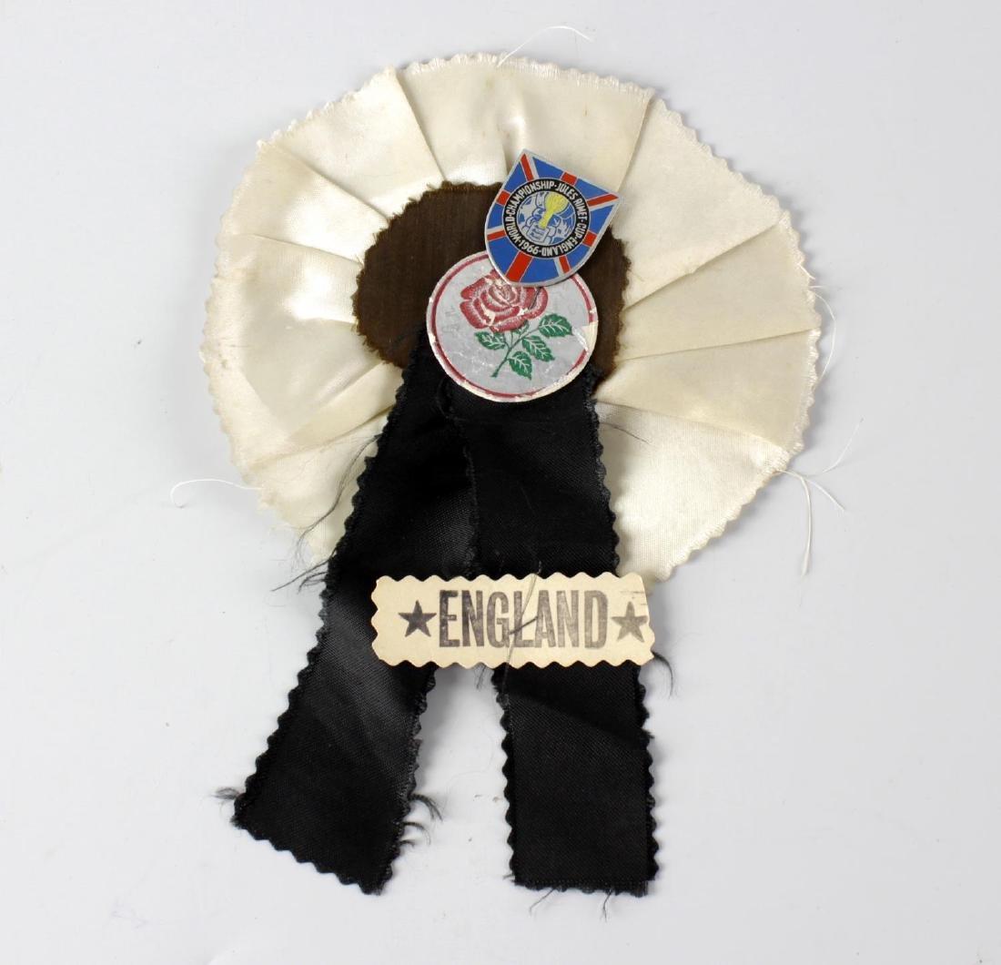An unusual printed metal shield shaped pin 'World