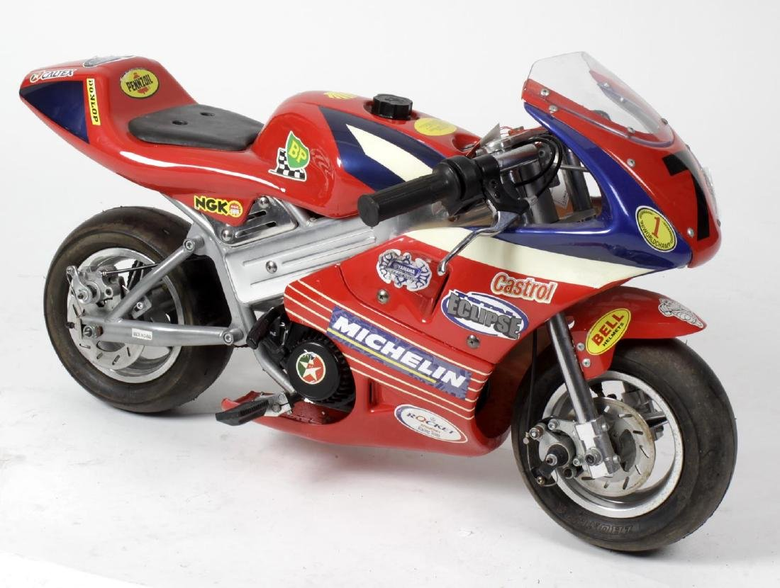 A miniature 'ride on' racing motorcycle, the tubular