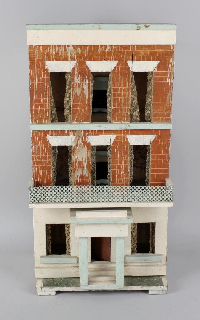 A late 19th century painted wooden dolls house of