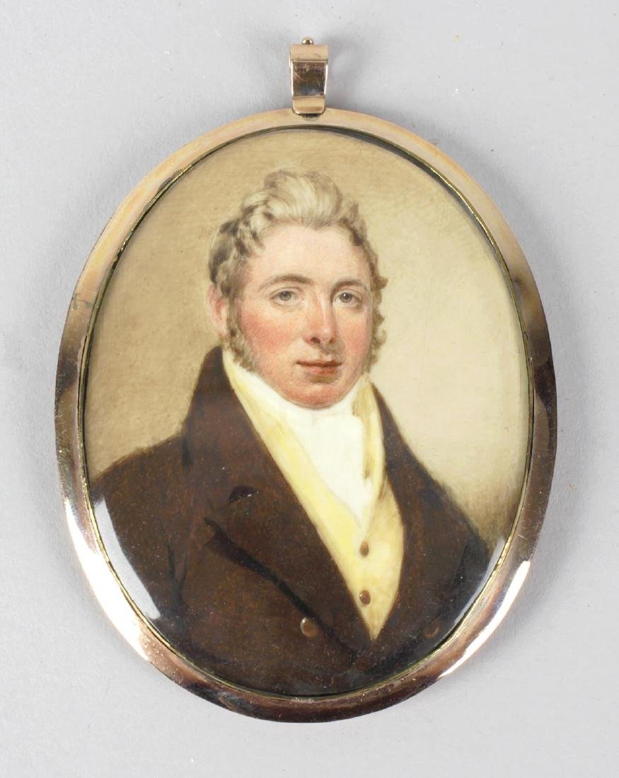 An early 19th century oval painted portrait miniature