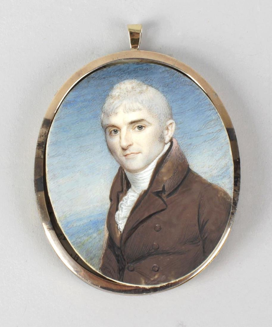 A 19th century oval painted portrait miniature upon