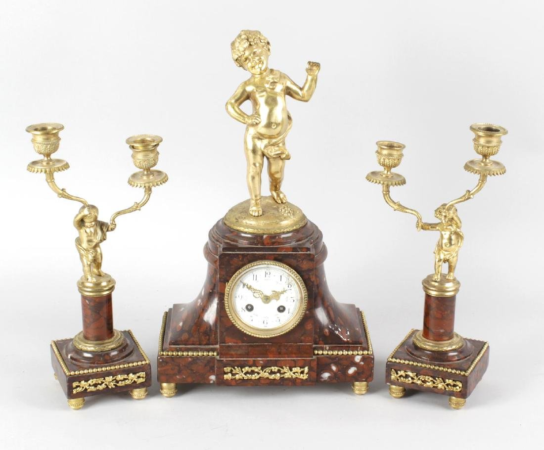 A late 19th century French three-piece clock garniture.