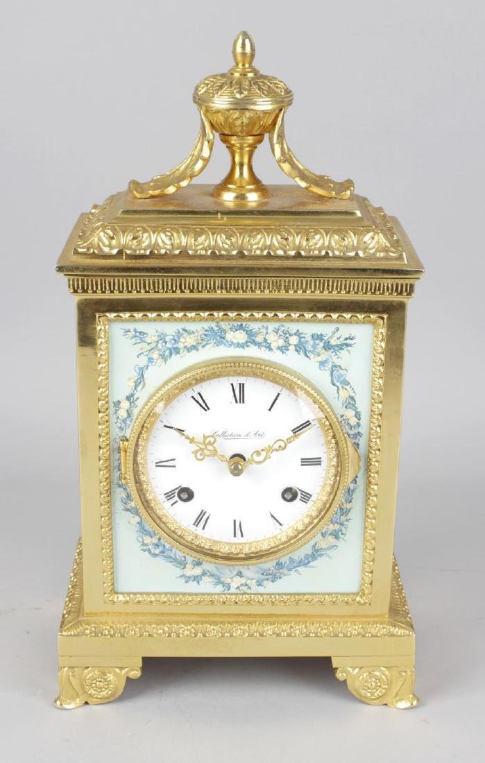 A modern gilt brass 'Collection D' Art' mantel clock.