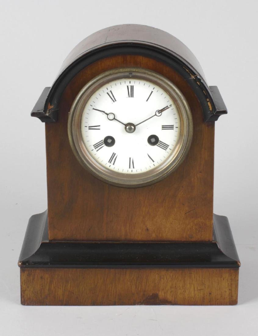 A small French walnut-cased two train mantel clock.