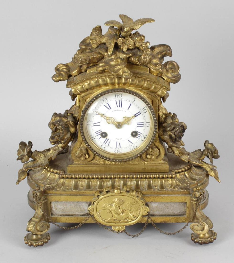 A 19th century gilt bronze mantel clock, the 3
