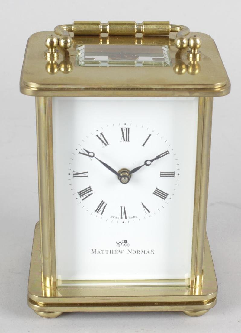 A boxed Matthew Norman carriage clock. The white Roman
