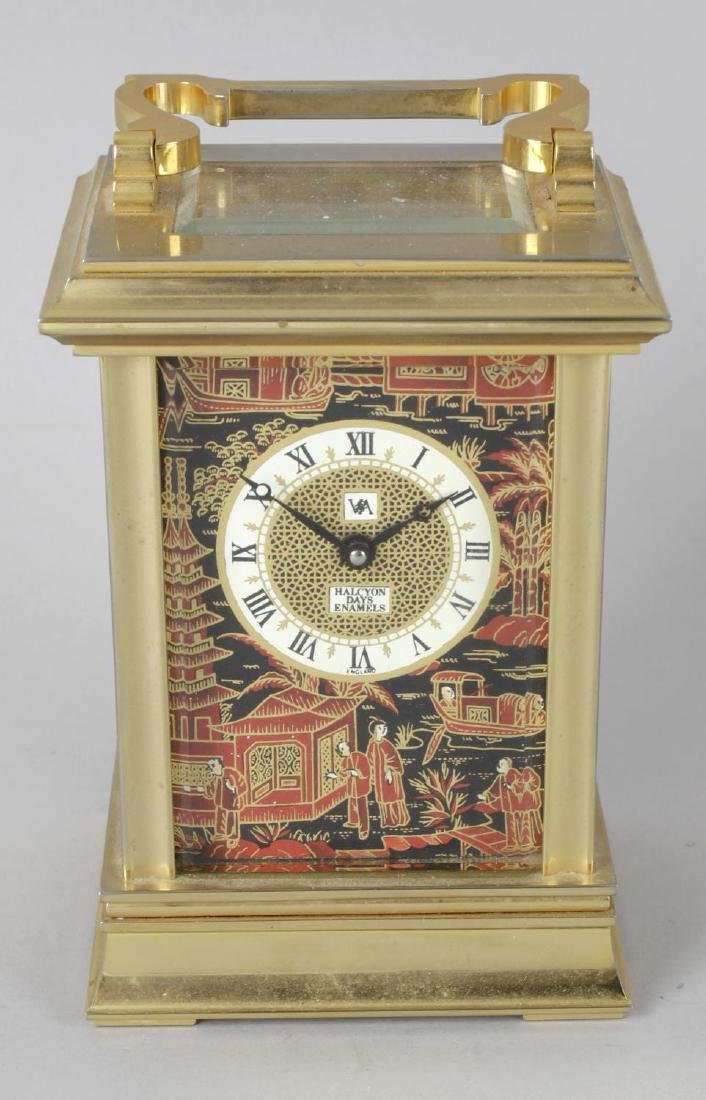 A Halcyon Days enamel carriage clock. The Roman dial