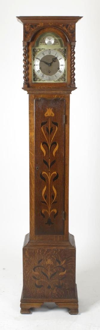 An early 20th century Arts & Crafts style inlaid oak