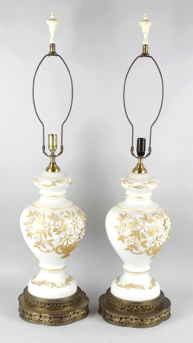 A pair of gilt metal mounted marble table lamps, each