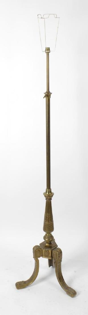 An early 20th century cast brass adjustable standard