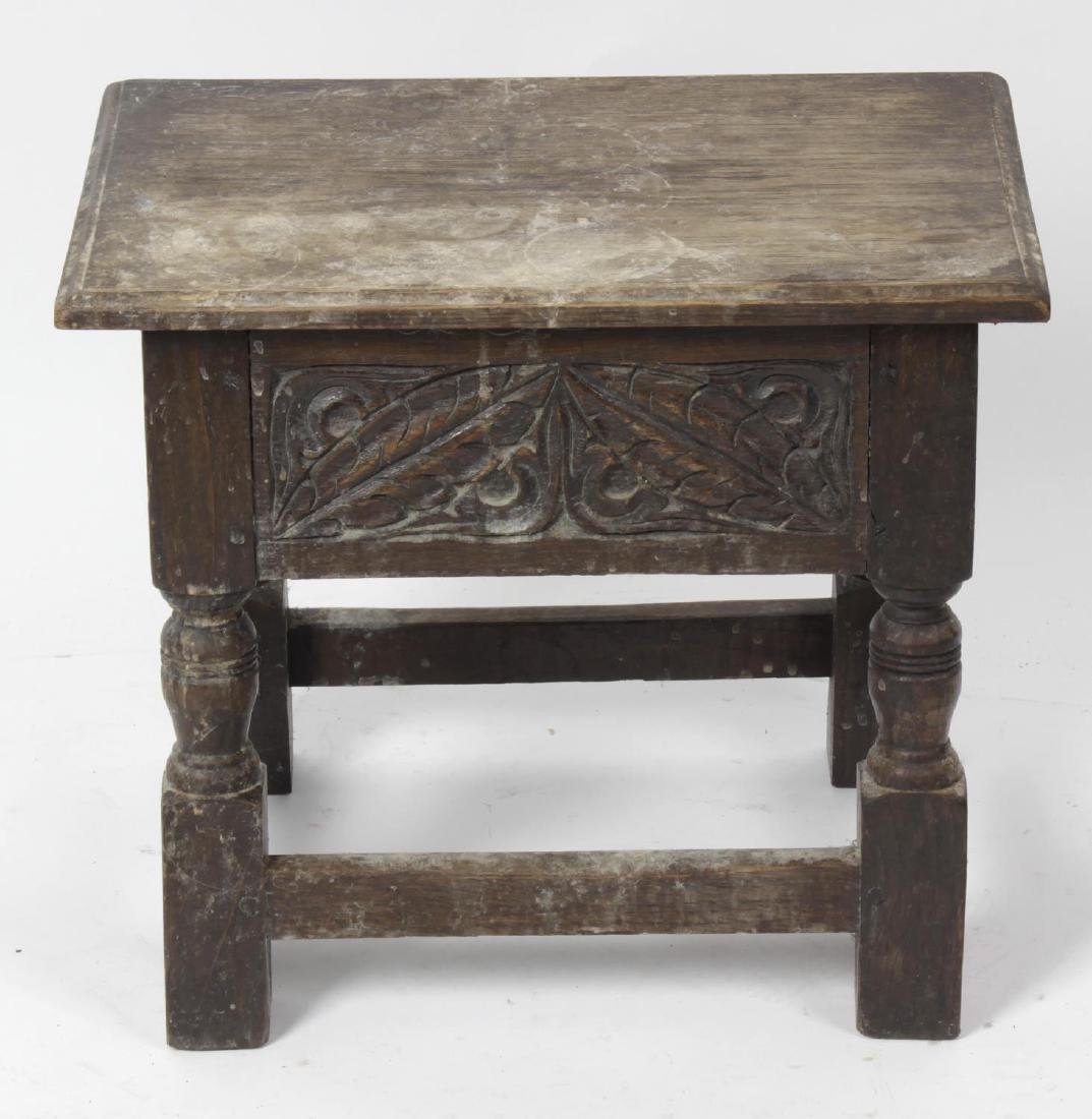 An early 20th century oak box stool. In the 17th