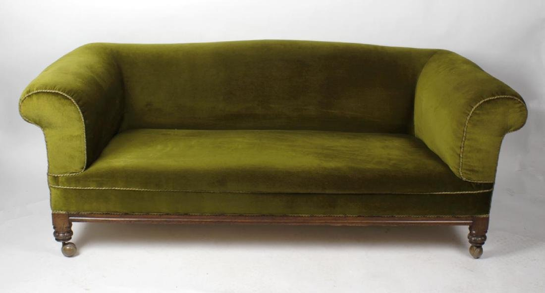 An oak-framed Chesterfield-style settee, circa 1900,