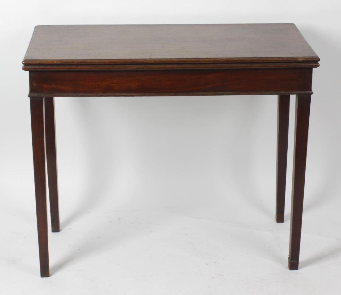 A George III mahogany fold-over tea table. The moulded