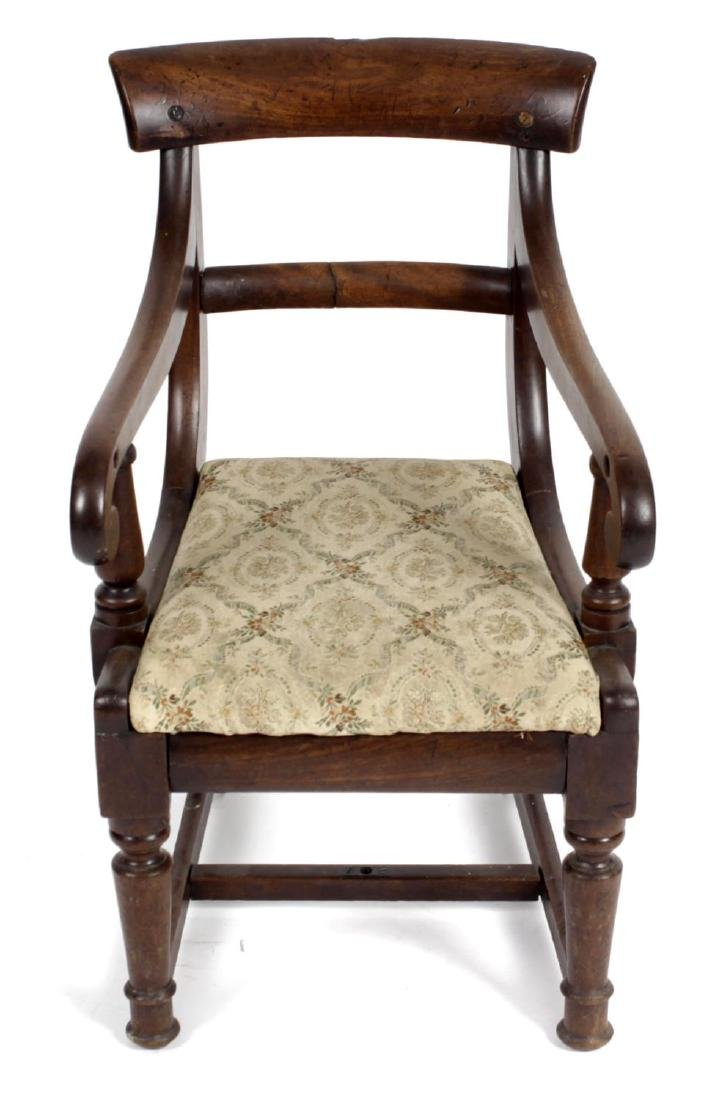 A 19th century child's mahogany chair. With plain top