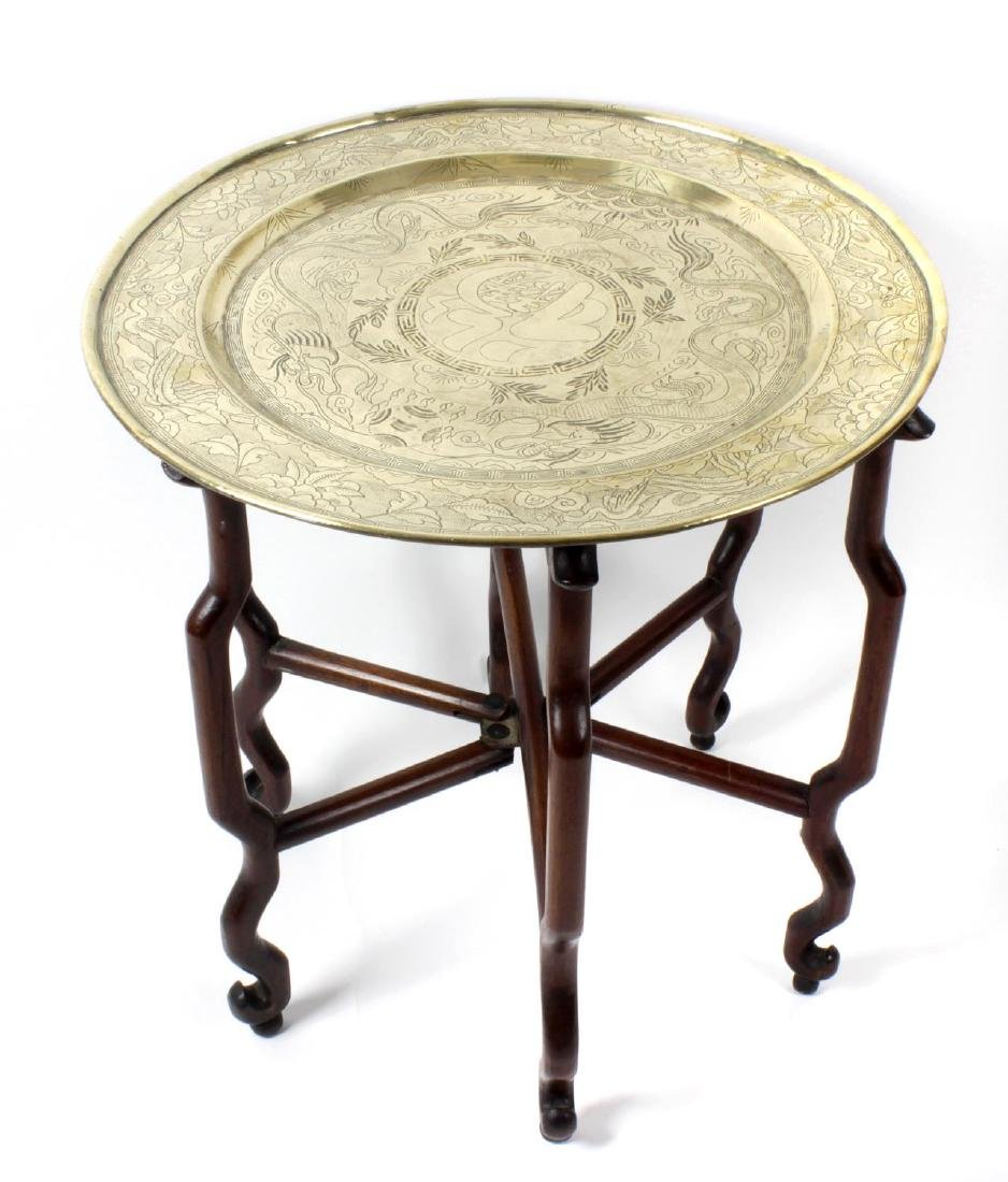 A Chinese brass-topped hardwood folding table. Early