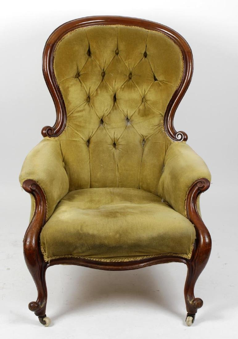 A Victorian walnut-framed deep-buttoned easy chair. The