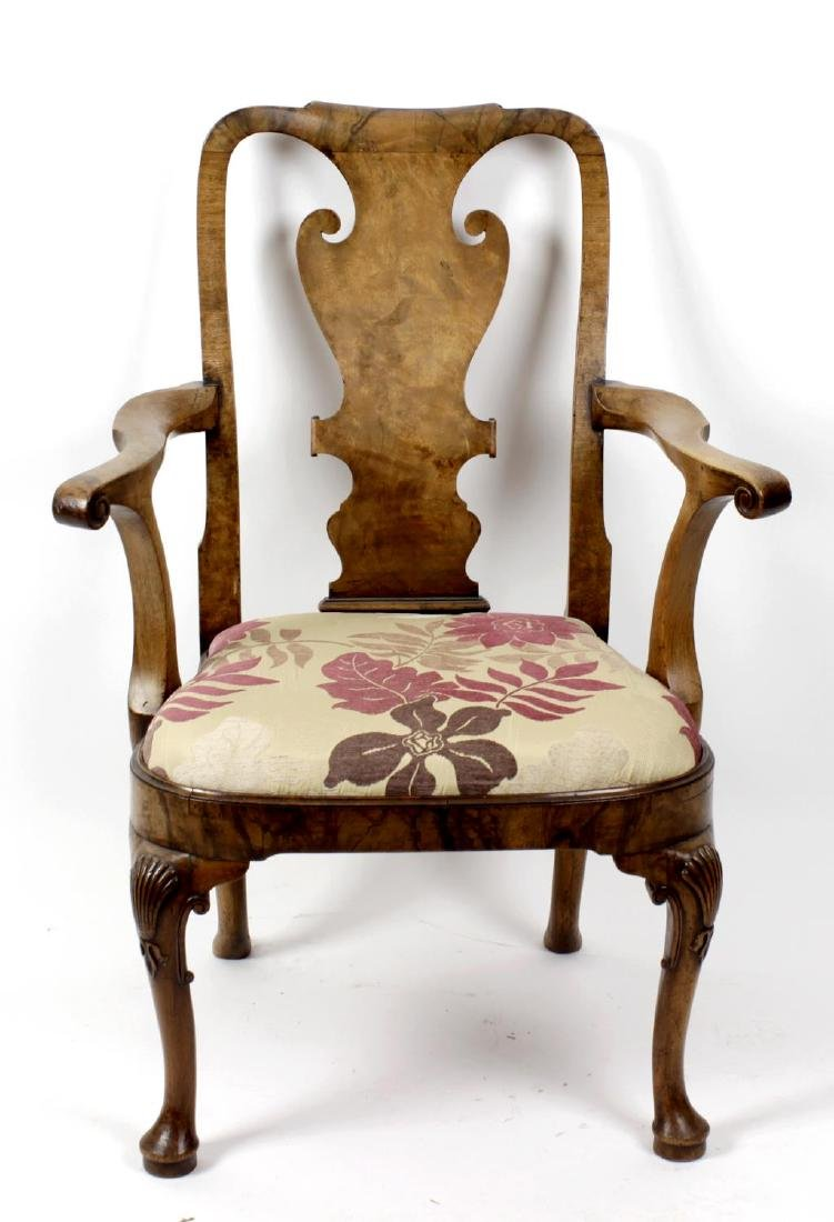 A early 20th century figured walnut elbow chair or