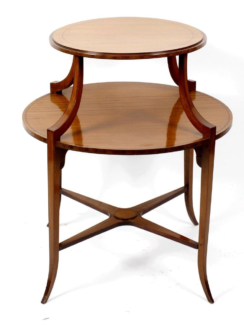An Edwardian satinwood two-tier occasional table or