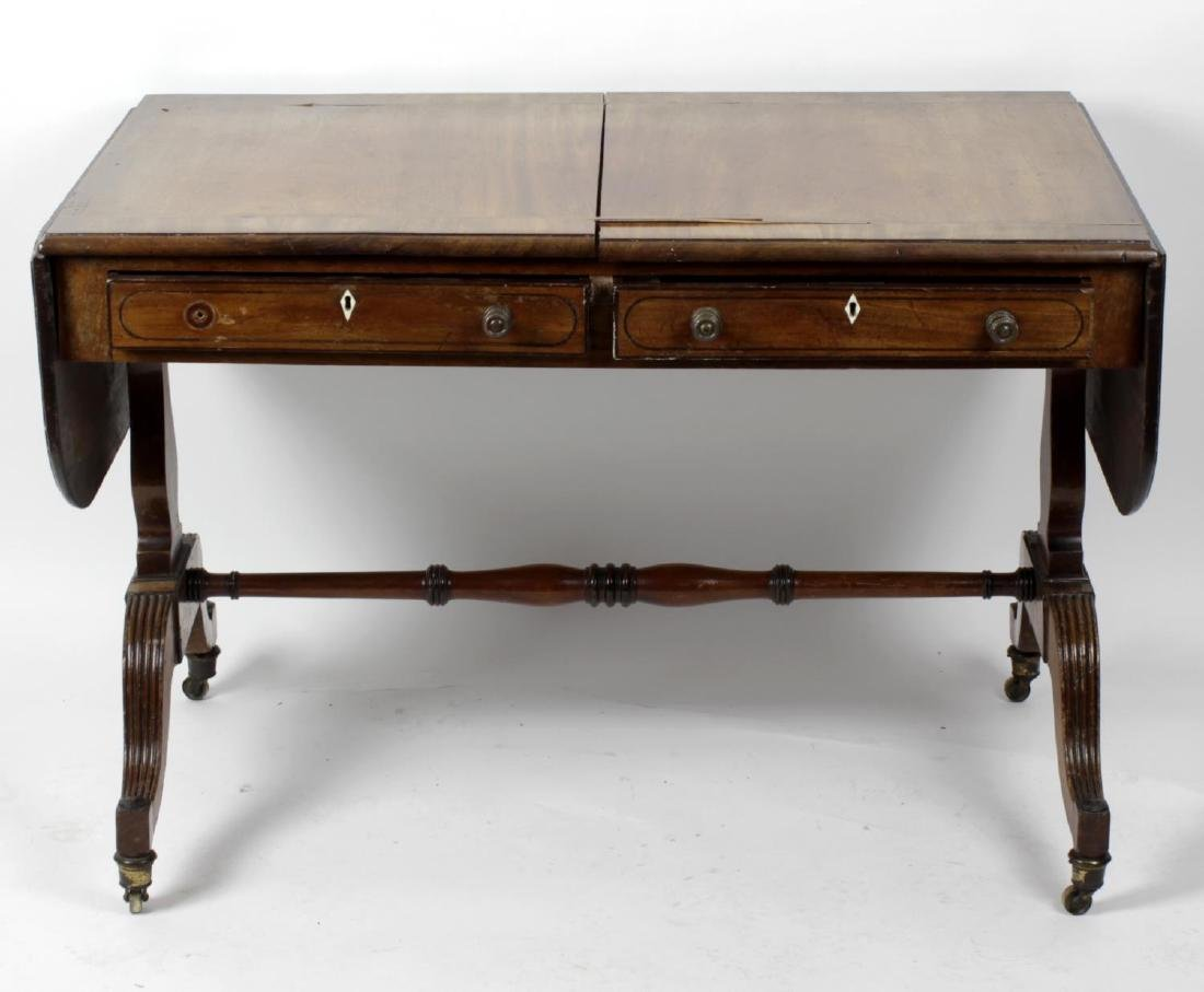A George IV mahogany pembroke table. The ebony and