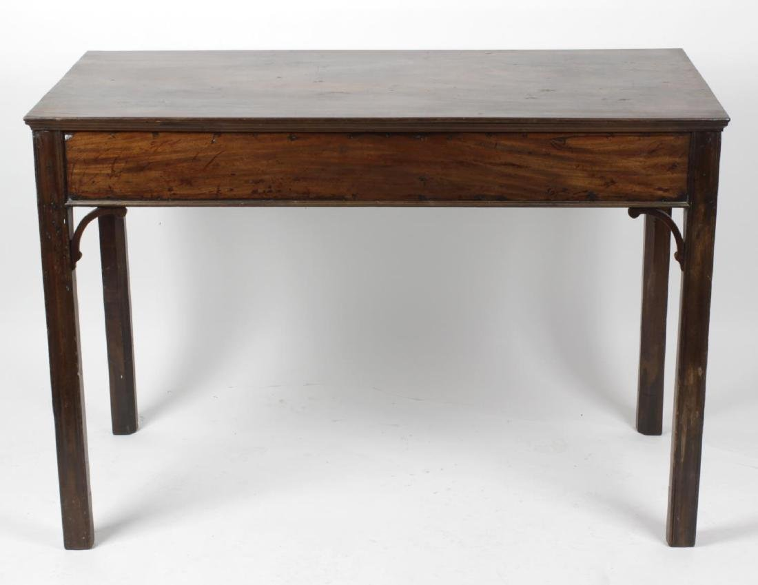 A George III mahogany serving table. The moulded