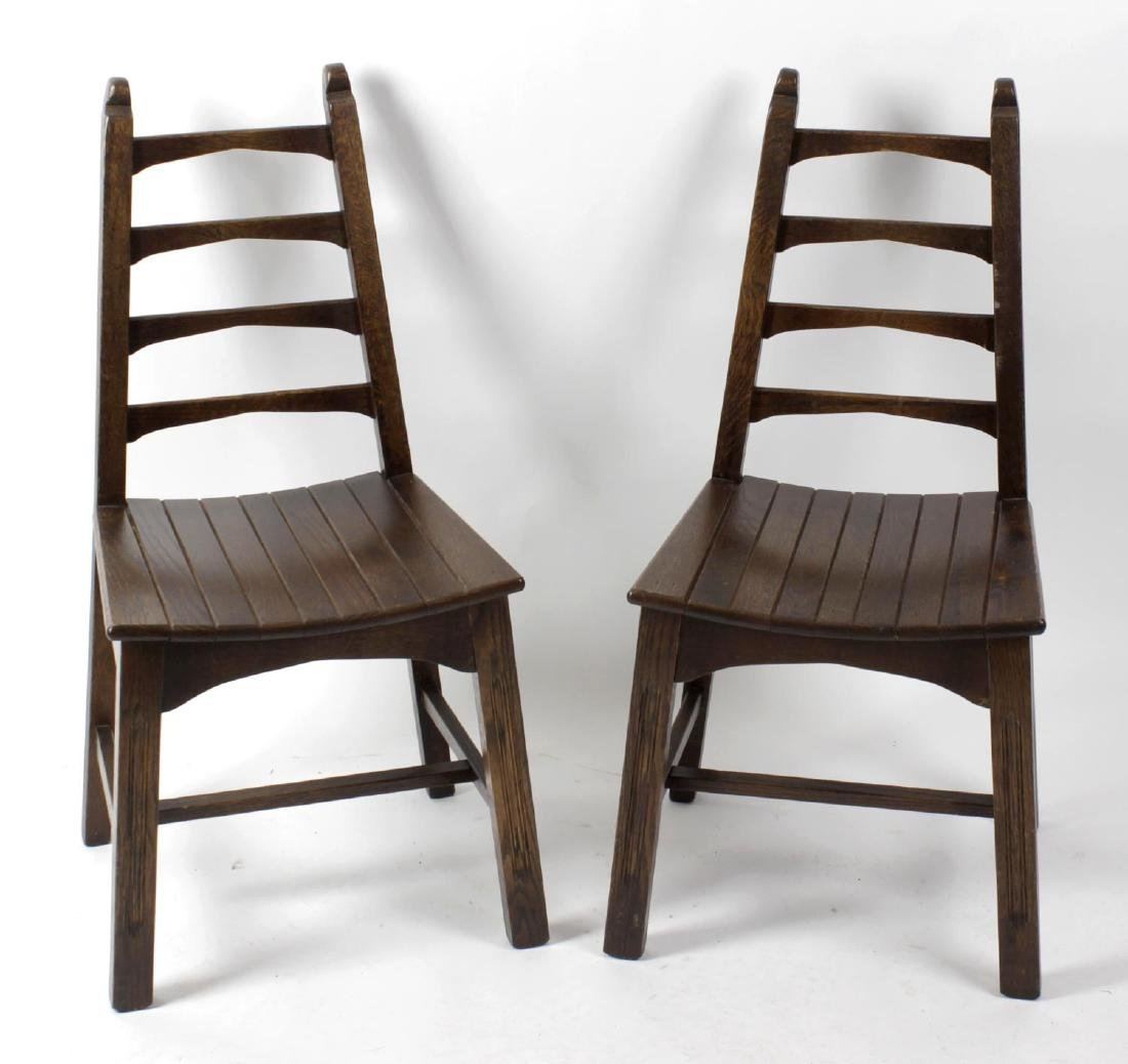 A set of eight 20th century oak dining chairs. Each of