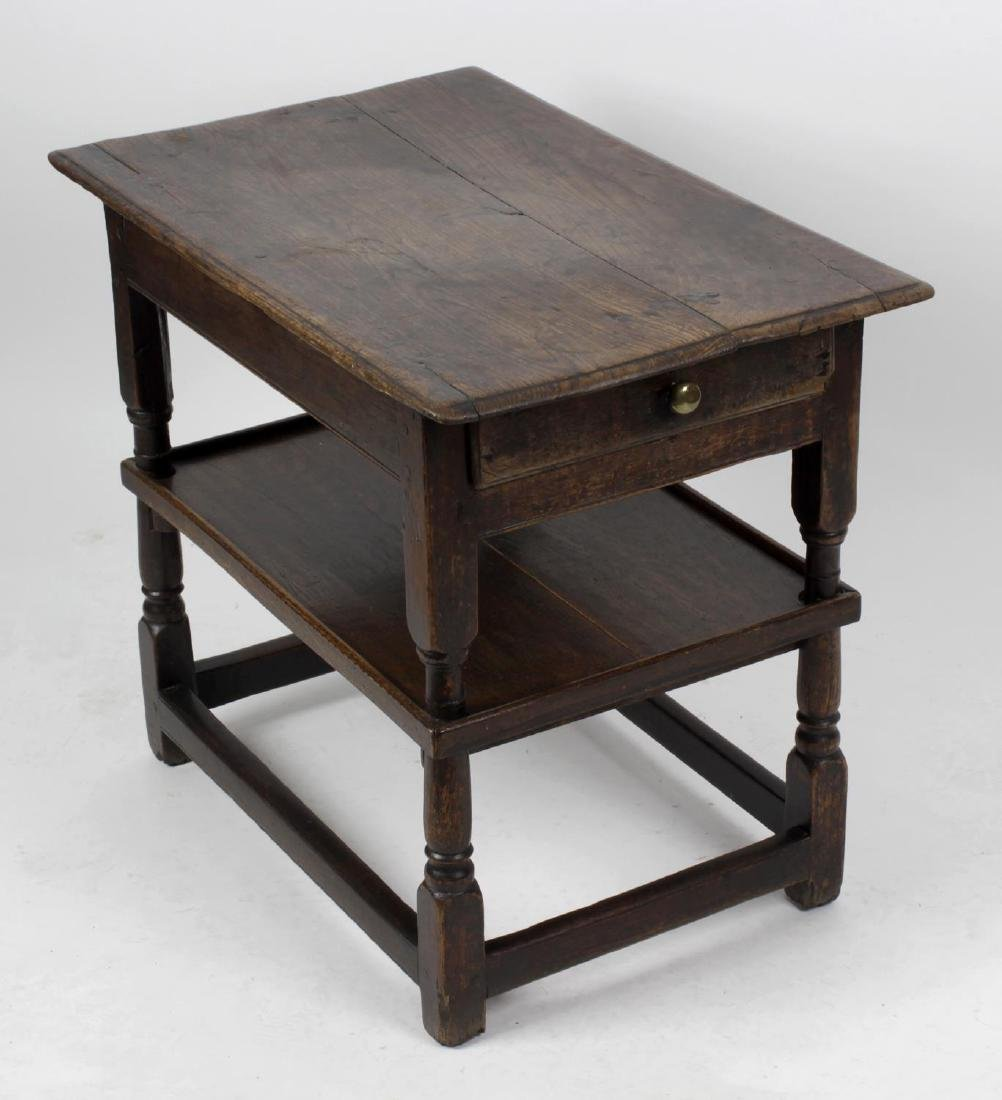 An early 18th century oak side table. The moulded