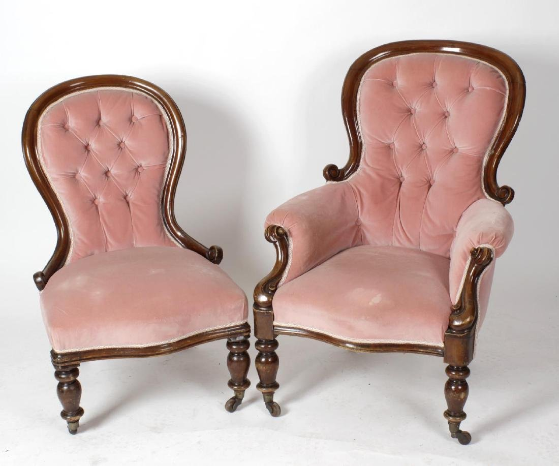 A near pair of Victorian deep buttoned easy chairs, for