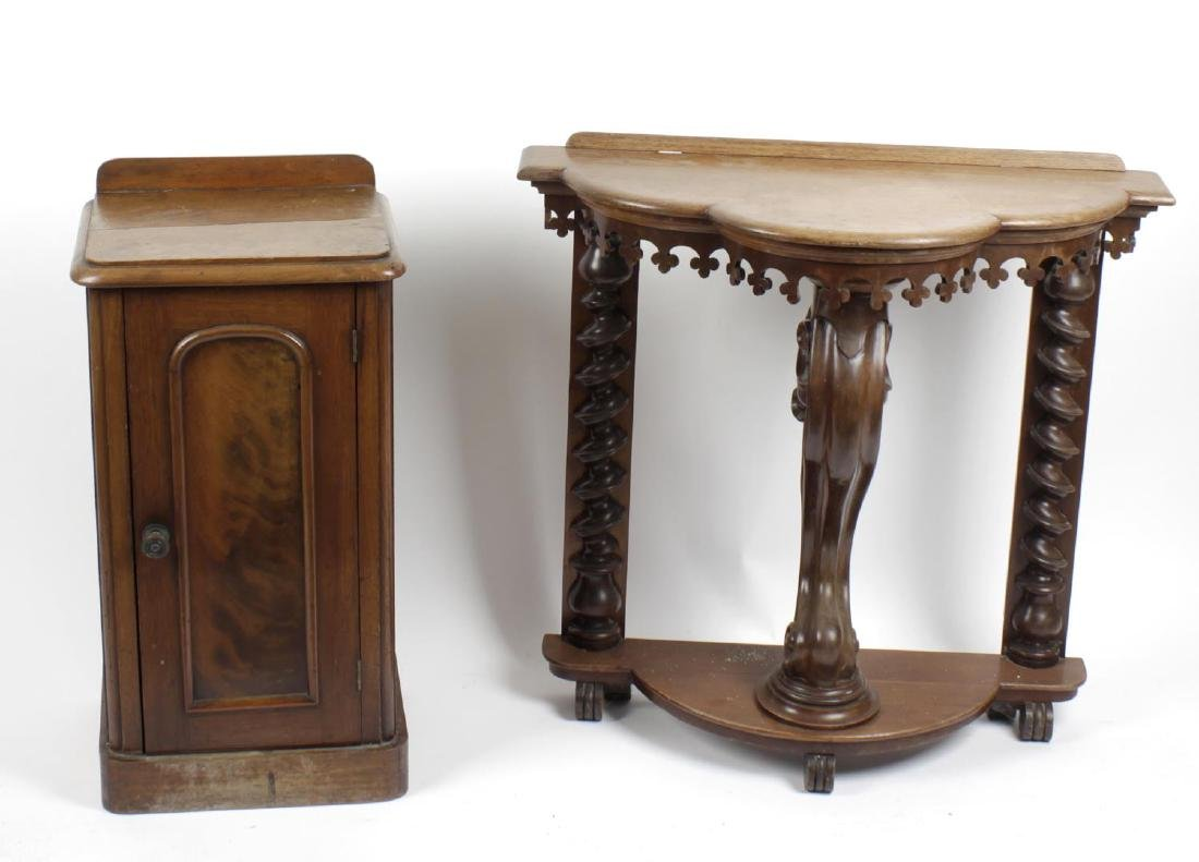 A Victorian gothic revival console table. The trilobe