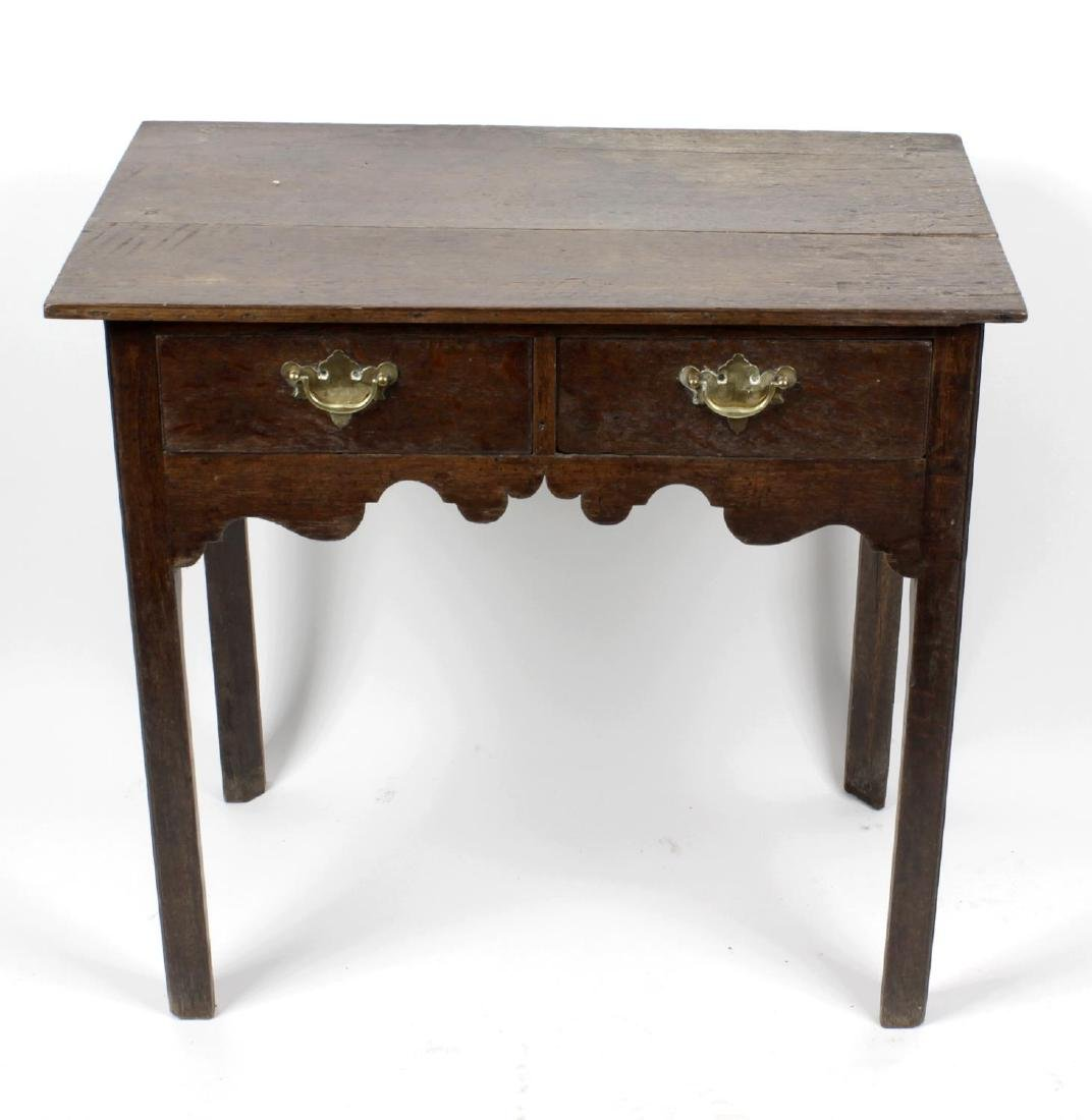 Two George III oak side tables. The first with two