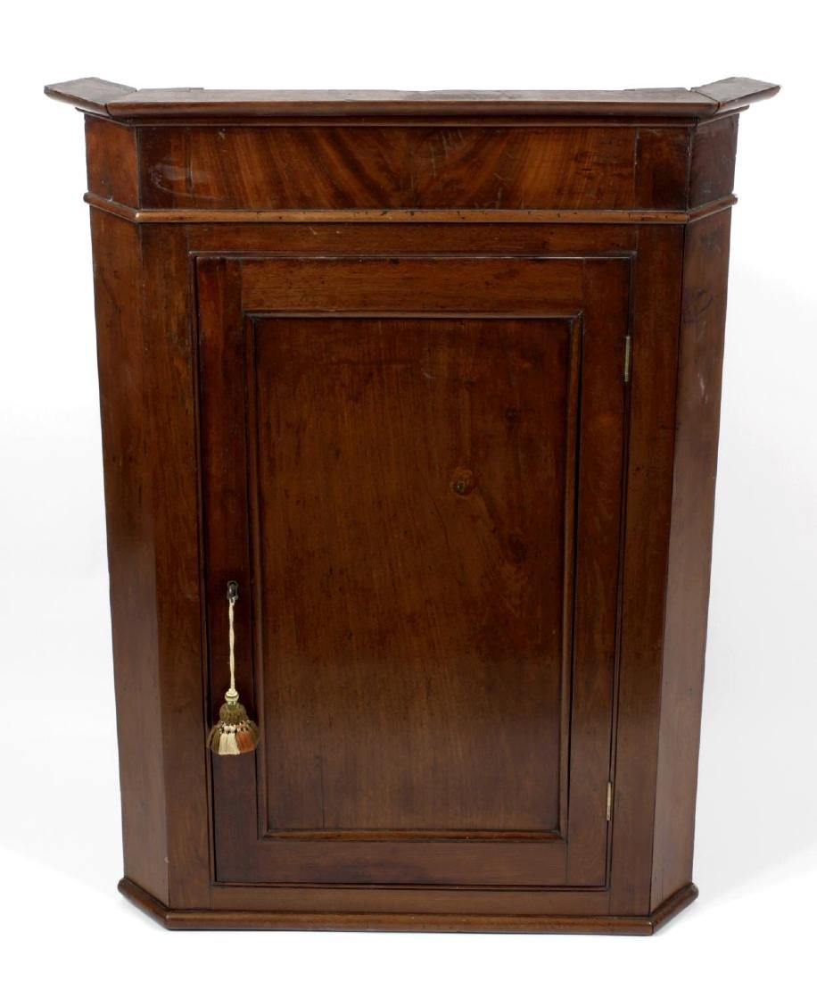 A group of three corner cupboards. The first with