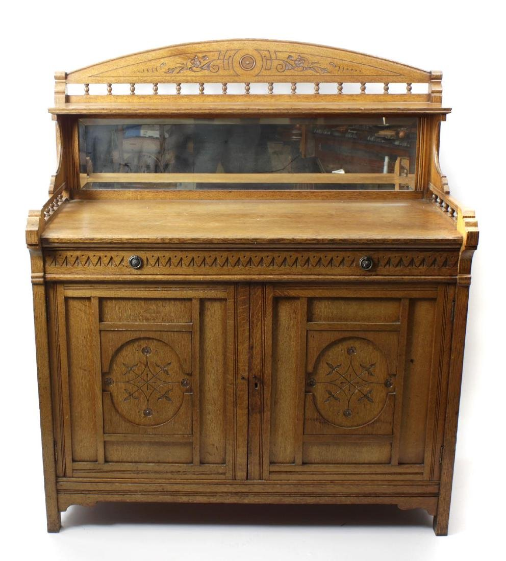 A Victorian Aesthetic period golden oak sideboard. The