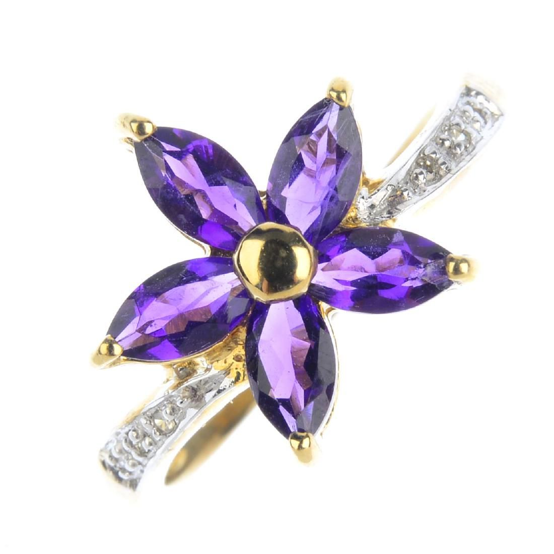 A 9ct gold amethyst and diamond ring. The
